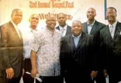 Pastor Poré hosting a Gospel Explosion at Carol Vance Prison posing with Alex Shannon and The Christian Voices